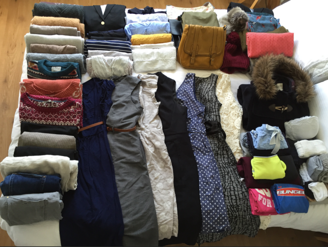 capsule wardrobe on bed after